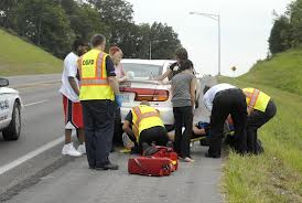 patient preparing to be transfered after MVA