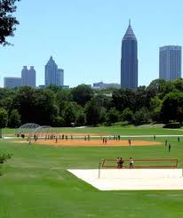 piedmont park with beach volleyball and midtown in background